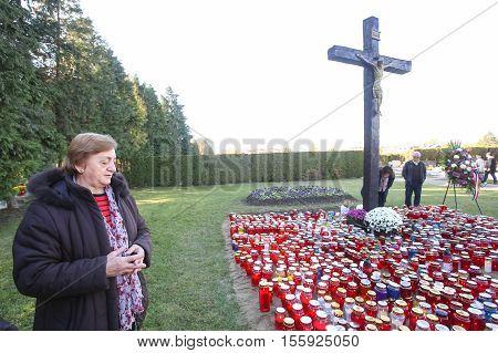 Woman Praying At Cemetery