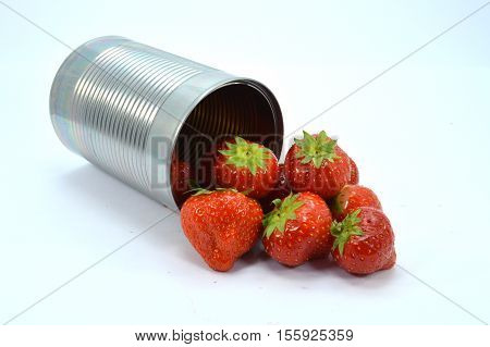 Outgoing bulk of strawberries a can in black