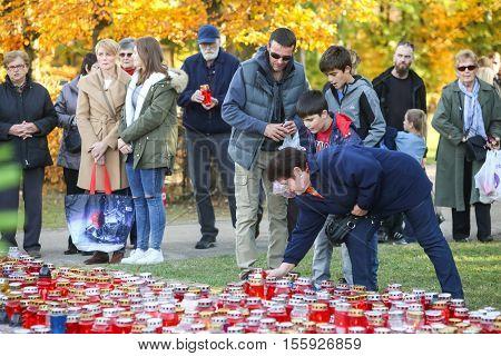 People Lighting Lampions At Cemetery