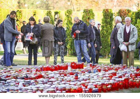 People Praying At Cemetery