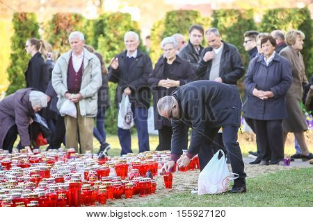 People Praying On All Saints Day