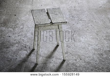 abandoned place with wooden stool on gray floor