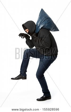 Burglar steals with blue bag