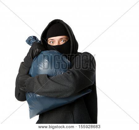 Terrible mugger holding large bag