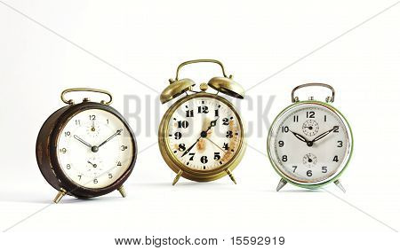 Three Old Vintage Alarm Clock Isolated On White