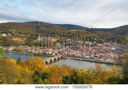Heidelberg: autumnal panoramic aerial view on the Old Town, the river Neckar, the Old Bridge and the castle from the Philosophers' Walk
