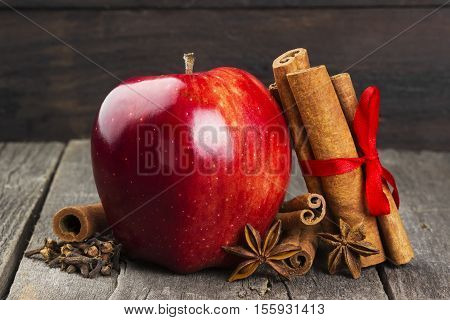 Apple, Cinnamon, Anisetree On A Dark Wooden Background
