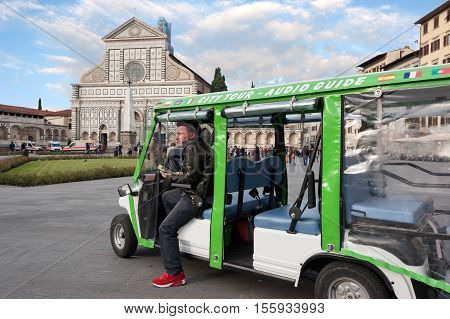 The tourist guide with electric vehicle waiting for customers in Santa Maria Novella square Florence