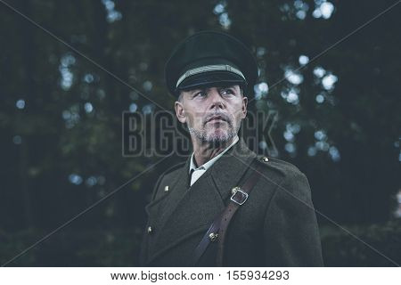 Alert Retro 1940S Military Officer Standing In Autumn Forest.