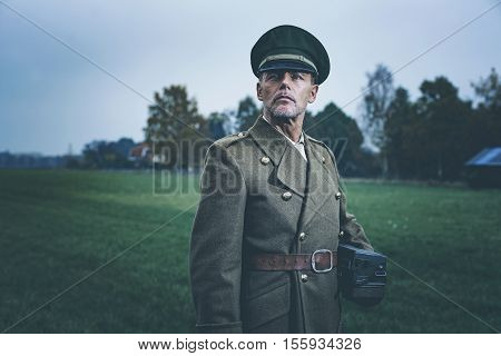 Retro 1940S Military Officer Standing In Field With Phone.