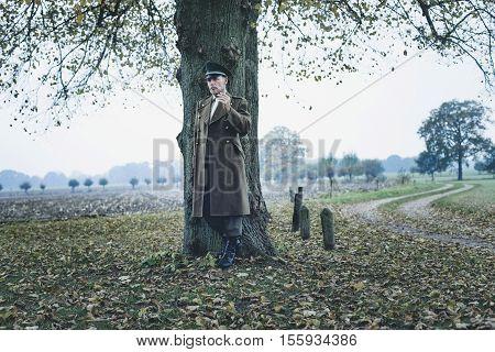 Resting Retro 1940S Military Officer Smoking Cigarette Under Tree.