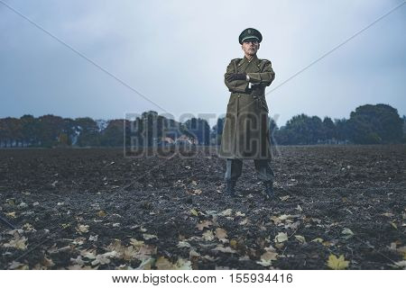 Patrolling Retro 1940S Military Officer Standing On Farmland.