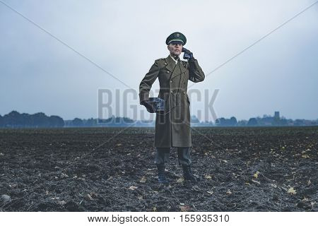 Retro 1940S Military Officer Calling With Field Phone On Farmland.