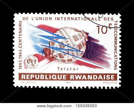 RWANDA - CIRCA 1965 : Cancelled postage stamp printed by Rwanda, that shows Telstar and ITU emblem.