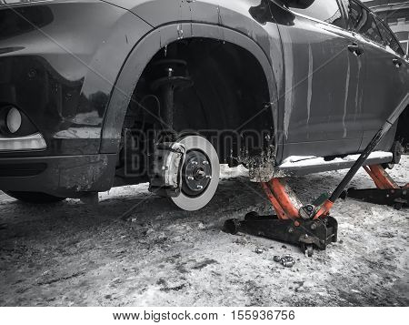 Replacing Wheels On New Black Suv Car