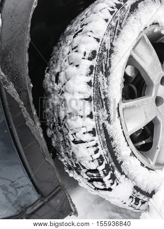 Car Wheel With Studded Tire In Snow