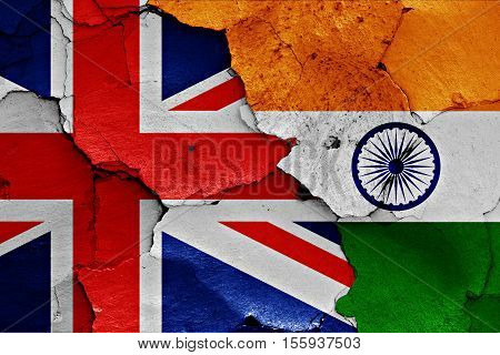 flags of UK and India painted on cracked wall