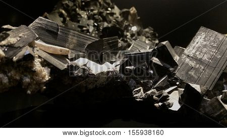 Closeup with selective focus of black tourmaline crystals