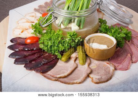 Traditional russian meat snack sliced and served with herbs