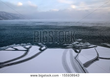 Strong wind breaks ice floes in a storm