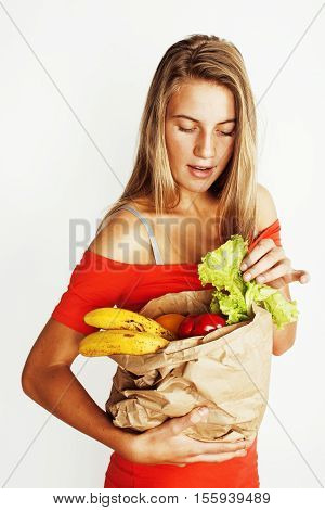 young pretty blond woman at shopping with food in paper bag isolated on white smiling bright, lifestyle real modern people concept
