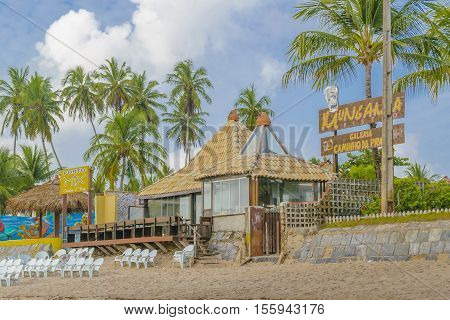 PORTO GALINHAS, BRAZIL, JANUARY - 2016 - Rustic style waterfront restaurant at tropical beach in Porto Galinhas Pernambuco Brazil
