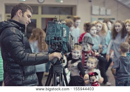 Minsk Belarus - November 11 2016: Video operator removes the children at the camera at a party