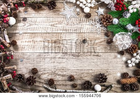 Christmas holiday background with pinecone balls. Greeting card branch old wooden board rustic style. Copyspace and top view