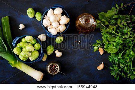 Dietary Menu. Ingredients: Vegetables - Brussels Sprouts, Mushrooms, Leeks And Herbs On A Dark Backg