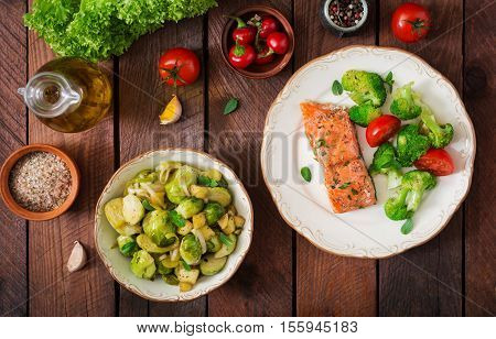 Baked Fish Salmon Garnished With Broccoli And Tomato. Dietary Menu. Fish Menu. Seafood - Salmon. Top
