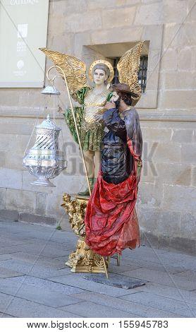 SANTIAGO DE COMPOSTELA, SPAIN - AUGUST 5, 2016: Human statues in the streets of Santiago de Compostela Galicia Spain