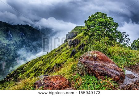 Mountains with dramatic sky.Sri Lanka landscape nature background.View from Adam's peak small Ella. Sri Lanka Sunrise in the jungles of Sri Lanka.