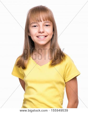 Half-length emotional portrait of caucasian girl wearing yellow t-shirt. Happy schoolgirl looking at camera. Funny cute smiling child, isolated on white background.