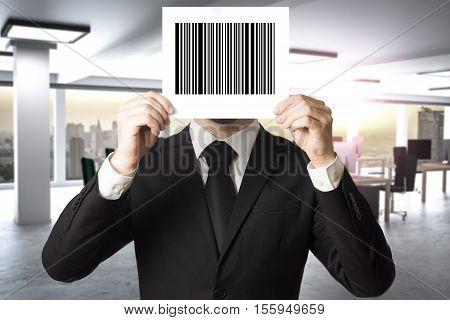 businessman in black suit hiding face behind sign barcode employee