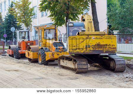 road repair, road machinery, paver and excavator