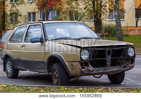 broken car abandoned in a Parking lot