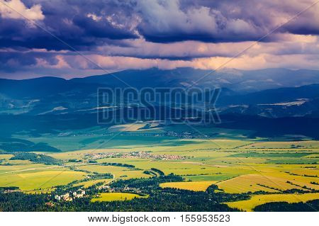 The picture captures the view of a person watching meadow reverie fantastic mountains and the clouds floating across the sky