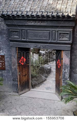 XITANG - FEBRUARY 20: The doors in the courtyard of Xitang Ming and Qing Dynasty Residence Wood Carving Exhibition Hall, Xitang town in Zhejiang Province, China, February 20, 2016.
