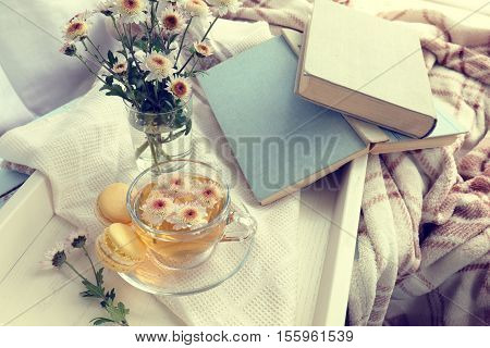 Cup Of Tea, Macaroons, Chrysanthemum Flowers And Books