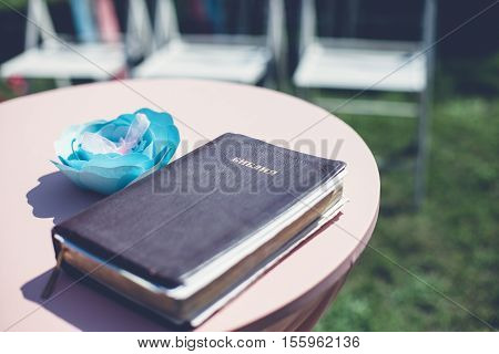 Photo of Holy Bible on the round table