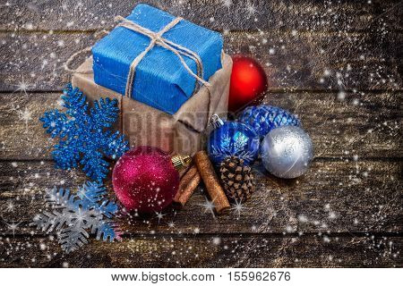 Christmas Gifts Decorated with Linen Cord, Cinnamon, Pine cones,christmas decoration.Toned image. Snow Drawn.Selective field of focus
