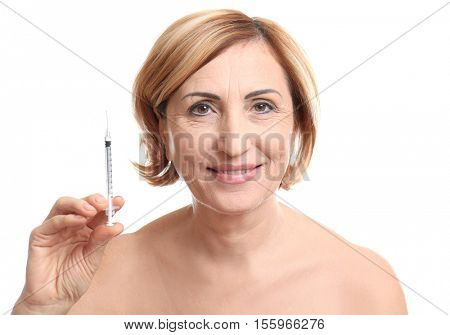 Senior woman with hyaluronic acid injection on white background