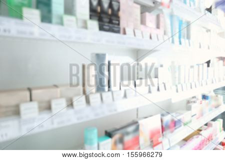 Blurred store shelves with various products background