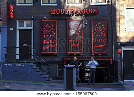 AMSTERDAM, AMSTERDAM - MAY 5, 2016: Red-light district in Amsterdam, Netherlands. Red light district is a part of city Amsterdam where is a lot of prostitution and sexoriented businesses.