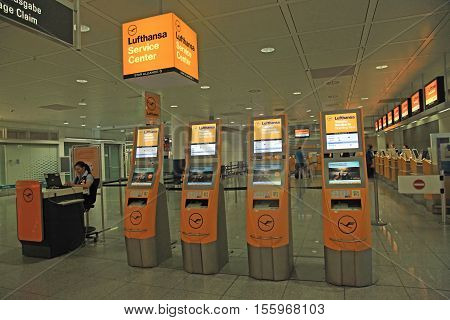 MUNICH, GERMANY - JULY 25, 2016: Lufthansa service center and self checkin machines at the Munich International Airport, Germany. The Munich Airport (MUC) Germany's second busiest airport is a major hub for Lufthansa (LH).