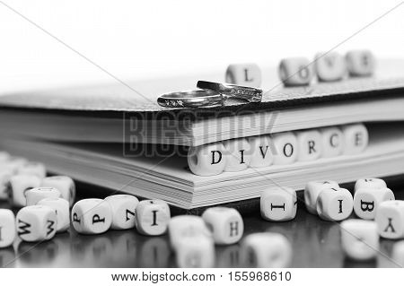 small white wooden blocks made up the word in the table