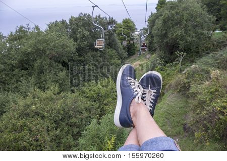 Feet Hanging from a Chairlift Up to Mount Solaro in Anacapri Italy