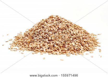 Heap golden oat flakes isolated on white background. Close up high resolution product.