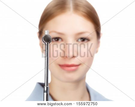 Young beautiful smiling woman neurologist in blue doctor's smock with reflex hammer isolated on white background. Shallow dof. Focus on hammer.