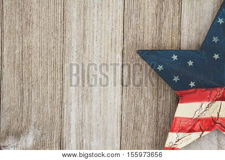 USA patriotic old flag on a star with weathered wood background with copy space for your message